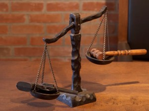The Scales of Justice Weight In for John Simpson, MAI
